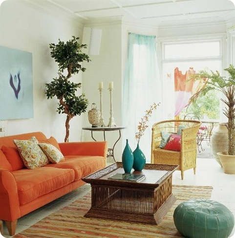 Living Room With Orange Couch, Blue Vases And Clue Pillow Seat