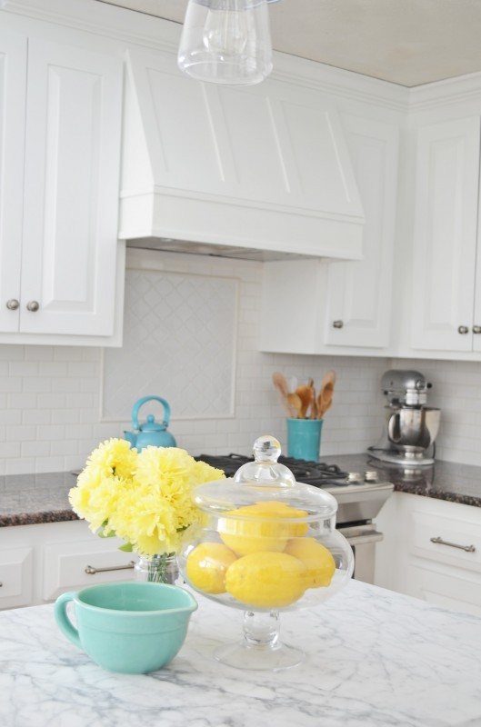 White And Grey Kitchen With Yellow, Blue And Silver Accents