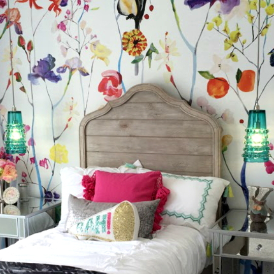 Floral Wallpaper With Wood Headboard And White Sheets And Colorful Pillows