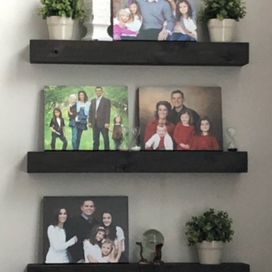 DIY Black Floating Shelves With Photos Displayed
