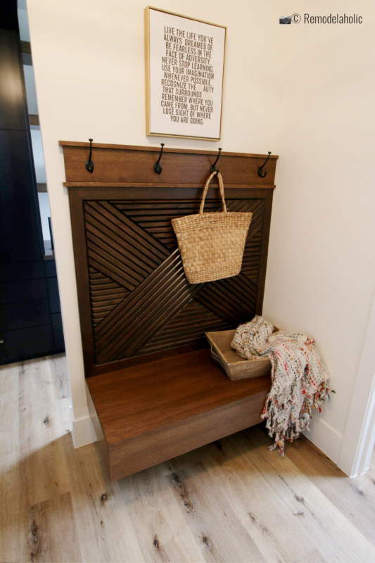 Add blankets and pillows for a cozy mudroom bench. SGPH 2019 House 04 Interstate Homes, Photo by Remodelaholic