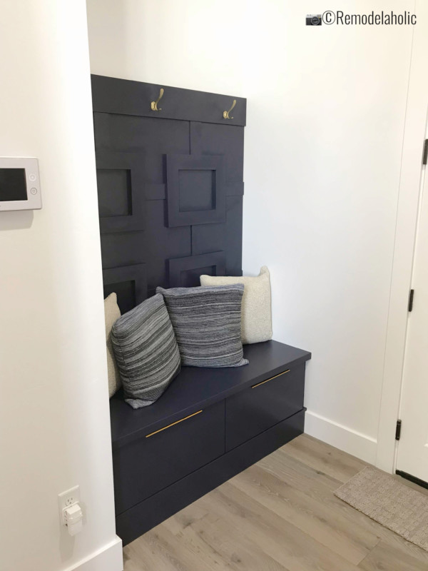 Add fretwork or board and batten and a contrasting color for a fun mudroom area. SLPH 2018 Home 20 The Building Group, Photo by Remodelaholic