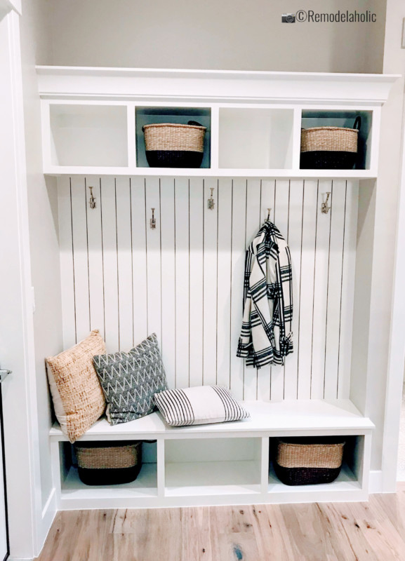 Add vertical shiplap above a bench with cubbies, SPGH 2019 House 27 Slate Ridge Homes, Inc, Photo by Remodelaholic