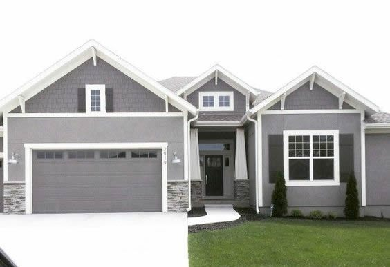 Garage Door Curb Appeal On Grey House With White Trim