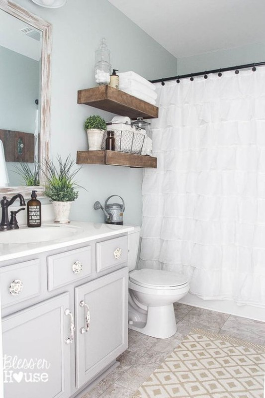White Bathroom With Grey Wall, Wood Floating Shelves And White Shower Curtain