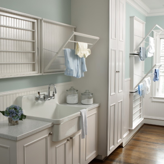 Beautiful Laundry Room With Fold Out Drying Racks