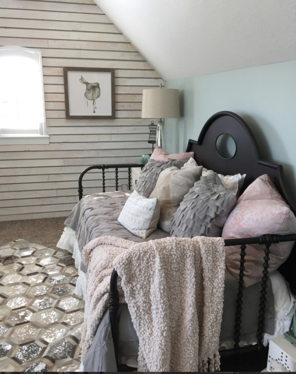 Bedroom With Black Bed, Grey, White And Pink Bedding, Wood Slab Wall And Blue Green Pastel Wall