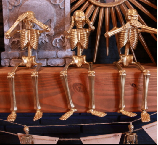 Gold Skeletons From The Dollar Store On Wood Mantel