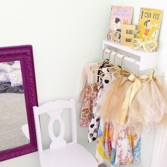 Hacks For A Perfectplayroom, Pictures Shows Dress Up Corner With Hanging Costumes, Mirror, Chair, Shelf With Books And Gold Sunglasses And Letter E
