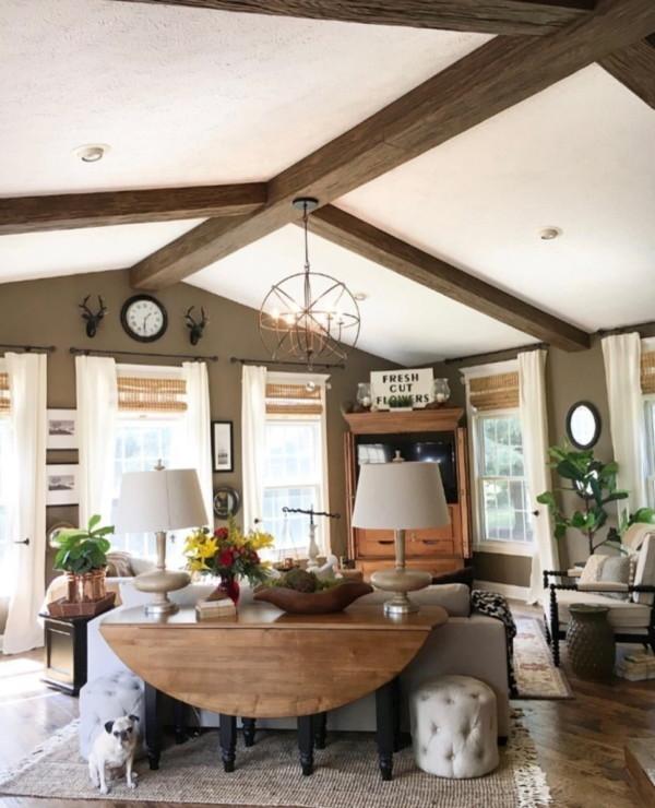 Living Room With Wood Beam Ceilings, Wood Table, Wood Floors