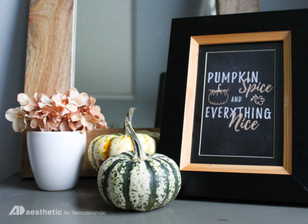 Pumpkin Spice And Everything Nice Printablein Gold And Black Frame With Orange And Green Pumpkins Next To It