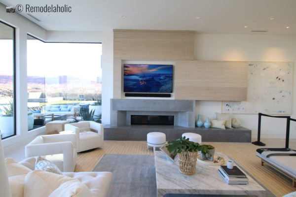 Fun way to hide a TV above a fireplace. SGPH 2019 House 20 Split Rock Fine Homes, Inc, Photo by Remodelaholic