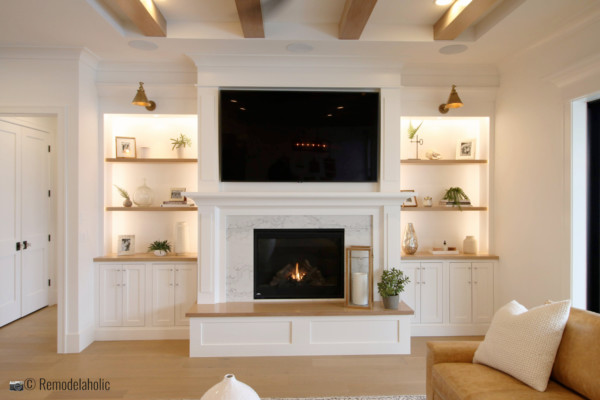 Decorating and styling neutral built-ins and mantel. SGPH 2019 House 24 K Welch Homes, Photo by Remodelaholic