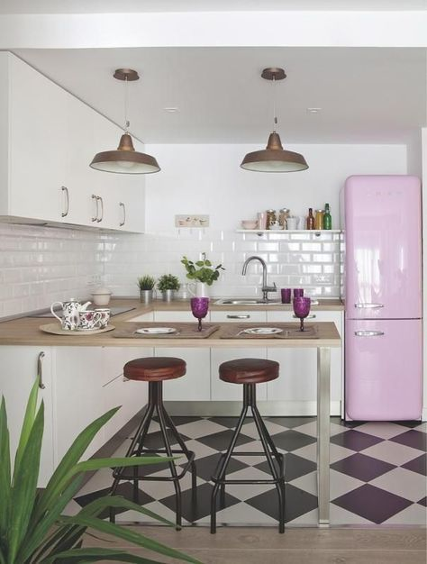 Vintage Kitchen With Checkered Floor And Pink Fridge