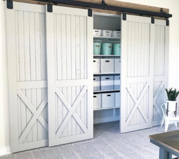 White Barn Doors Opening To Organized Closet