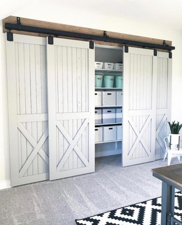 White Barn Doors Opening To Organized Closet