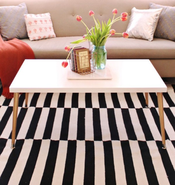 White And Black Rug With White Coffee Table And Gold Metala Legs