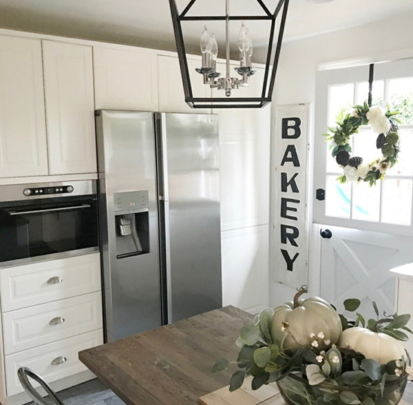 Farmhouse Kitchen In The Fall White With Green Leaves And Pumpkins And Flowers
