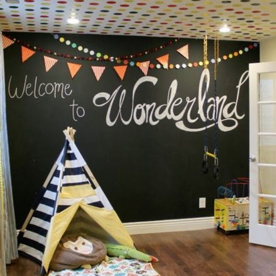 Chalkboard Wall With Small Striped Teepee And Colorful Poka Dot Ceiling