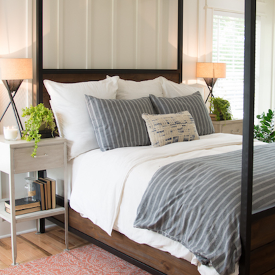 Fixer Upper Graham House Master Bedroom, Wood Bed With White Bedding And Grey Accents