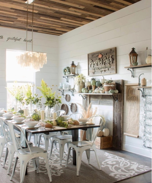 Pumpkin Mantel With Pumpkin Patch Sign And Beautiful Fall TableScape On Barn Wood Table And White Metal Chairs