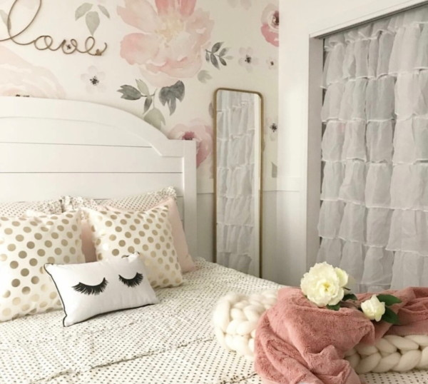 White Bed With FLoral Accent Wall And White Curtained Closet And Blush Accents