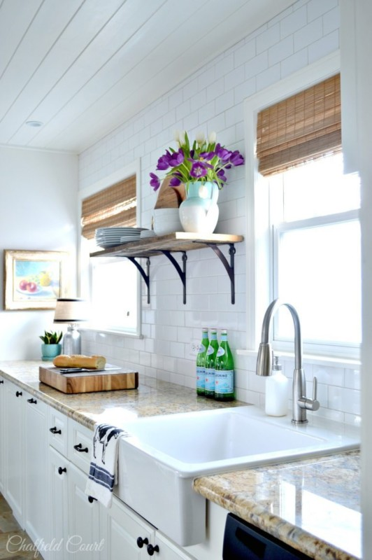 White Kitchen With Brown Accents And Custom Plank Ceiling