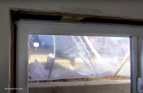 Installing New Basement Windows In 1960s Basement Remodel #remodelaholic