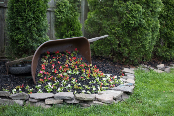 Creative Flower Bed Idea, Diy Tipped Wheelbarrow Planter The Honeycomb Home