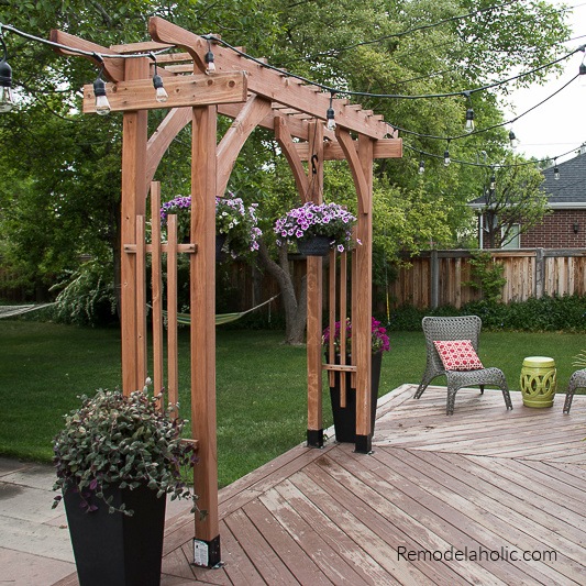 How To Build A Wood Garden Arbor For A Backyard Wedding Arch #remodelaholic