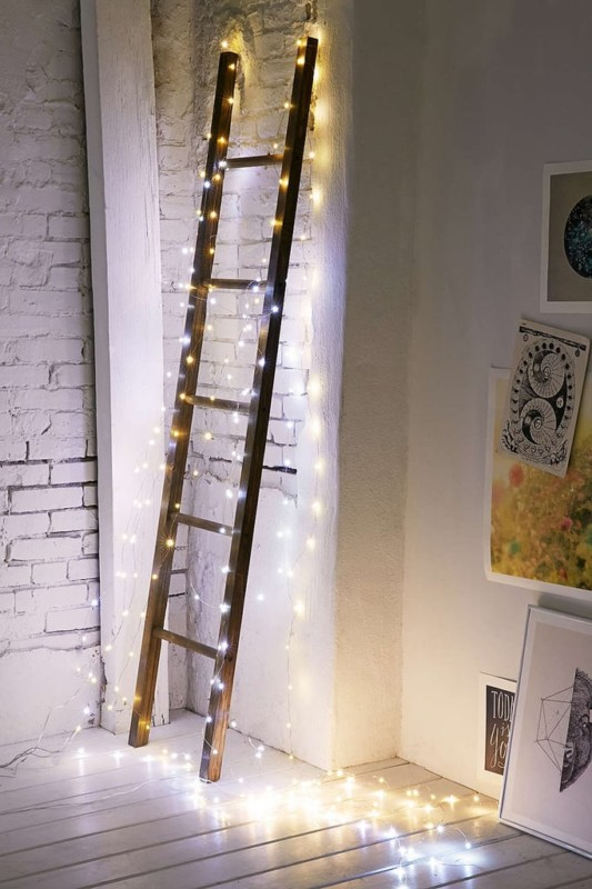 Wood Ladder Decor Idea With Lights For Nightlight Or Christmas, Via Urban Outfitters