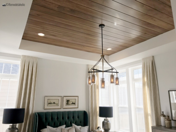 SLPH Model Home 1 Holmes Homes with wood ceiling planks, green headboard and more!