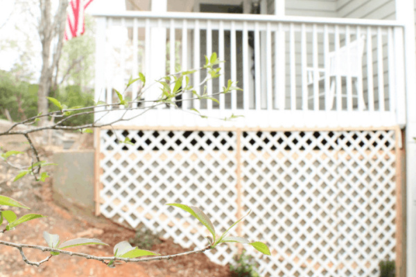 How To Install A Wood Trellis For Roses And Flowers Along A Concrete Porch Foundation Wall, Top Shelf DIY On Remodelaholic