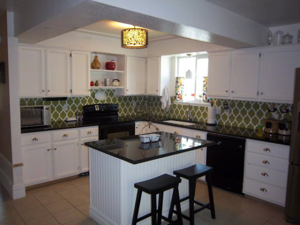 White Kitchen Remodel With Beadboard Cabinets And Stenciled Backsplash